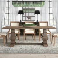 Capturing the feel of the French countryside, this dining table brings cottage charisma to your dining room ensemble. Made from solid pine wood and veneers, it showcases a thick, faceted double pedestal base, a planked top, and a natural weathered pine finish that is sealed to prevent splintering. This 84