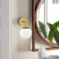 With a sophisticated spherical shape and gorgeous glass shade, this Globe 1-Light Armed Sconce puts a signature stamp on your modern living space. Chic and design-forward, this beauty lifts the ambiance in an entryway or dining area, or anywhere your home calls for generous lighting.