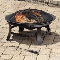 The Ebern Designs Brant Wood Burning Circular Fire Pit in Rubbed Bronze is a beautiful way to add warmth and atmosphere to your backyard or patio. Made of steel construction with a rubbed bronze finish, this circular outdoor fire pit is designed with fire bowl with an ash catcher, mesh spark guard lid for easy wood replacement access, wood grate and to maintain consistent air circulation and holes at the bottom of the pit for proper water drainage. The mesh wire cover, fire bowl and wood grate...