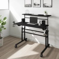 Mix industrial and modern styles together with this inbox zero rolling and adjustable writing desk. This desk is perfect for home-office spaces with its small footprint and offers the option of 2 separate desktops independent levels with ample space that includes an adjustable height mechanism. The finish coordinates with almost any decor while fiber-like texture tabletop surface and powder-coated metal frame and legs that give this desk a sturdy build along with a fun design. The desktop is...