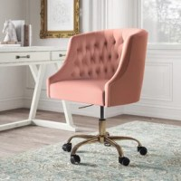 This isn't your standard office chair – but you didn't want standard anyway, did you? It showcases a modified wingback design with a rounded back and sloped, recessed arms for an elegant look. Button-tufted details dot the back for a touch of texture. This office chair is upholstered in velvet fabric with a solid hue that adds a glam, modern touch to your home office. Down below, it features gold-finish metal legs and five casters that allow smooth movement across your carpet or floor....