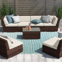 Enjoy a beautiful outdoor seating area with our patio furniture and make every day feel like a vacation. This fabulous set requires no assembly and can be used right out of the box. Solidly constructed with top quality PE resin wicker handwoven around a rust-free powder-coated aluminum frame, it is designed to withstand the elements. The seating comes with easy-to-clean, weather-resistant Sunbrella or Spuncrylic cushions, while the coffee table is topped with glass to protect the wicker from...