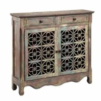 With its scalloped apron, weathered details, and medallion-inspired panels, this eye-catching cabinet lends statement-making style to any space.
