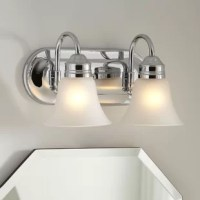 Give your bathroom a quick update, by changing something so simple as the lighting fixture, and bringing some new flattering illumination to your space. Take this statement-making vanity light for example, perfectly suited for a modern aesthetic, it features a curved backplate, that supports two bell-shaped shades. Crafted from steel, with white glass shades, this hardwired luminary accommodates two A19 medium-base 100 W lightbulbs (bulbs not included).
