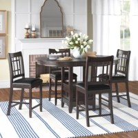 Utilizing the traditional elements of Mission styling, Dalary 5 Piece Counter Height Extendable Dining Set adds the feel of the early 20th Century design movement to your casual dining room. The pedestal table base supports an oval top and features storage accessible behind the drop-panel door. Framing, unique to the mission style, carries from the chair backs to the table base. The dark cherry finish serves to highlight the wood veneer.