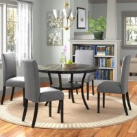 Make your kitchen or dining room a style destination with this 5-piece dining set. It includes one table and four chairs, all crafted from a mix of solid and engineered wood in a neutral hue that blends in easily with any color palette. The four chairs boast black tapered legs, nailhead trim, and a foam-filled seat upholstered in a cotton and linen blend for a touch of texture. And the rounded table showcases accents along the side and a curved metal frame for a sleek look.