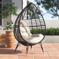 Lend a distinctive look to your outdoor seating arrangement with this teardrop-shaped patio chair! Crafted from wicker, it stands atop four slim legs and features a seat that takes on an openwork silhouette. Cushions fitted with removable, water-resistant covers give you and your guests a place to relax in the afternoon sun with a book or join a lively fireside discussion.