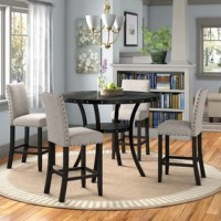 Make your kitchen or dining room a style destination with this 5-piece dining set. It includes one table and four chairs, all crafted from a mix of solid and engineered wood in a neutral hue that blends in easily with any color palette. The four counter-height chairs with a handy footrest are upholstered in a cotton and linen blend, and feature nailhead trim along the side for a decorative touch. And the rounded table showcases subtle accents and a curved metal frame for a sleek look.