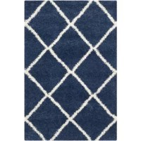 Looks aside, area rugs help absorb and decrease noise as they soften the step of hardwood and tile flooring. This one is constructed from a synthetic material designed to stand up to muddy shoes in the entryway and the occasional spill under the kitchen table. It features a pile height, making it the perfect pick for adding a plush stage setter that promotes coziness in the living room, bedroom, and beyond.