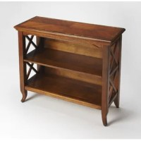 Whether using this piece as a bookshelf or as a place to simply showcase some decorative favorites, it's sure to be a stylish selection for your space. Crafted from solid and manufactured wood, it comes perched atop cabriole legs and boasts crown molded detailing, lending a touch of tradition to your ensemble. Two shelves accented by x-shaped side supports are perfect for some photographs or well-thumbed novels, while a neutral finish allows it to blend with your color scheme.