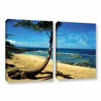 Palm Tree in Paradise by Kathy Yates 2 Piece Photographic Print on Gallery Wrapped Canvas Set. This canvas allows you to take in the beauty of a beachfront without having to leave the room. As this canvas reproduction is gazed upon just try not to imagine yourself with the sand between your toes and the gentle touch of water rushing up the shore.