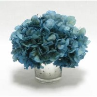 An elegantly worn mercury Mini glass pot lends a vintage feel to this preserved hydrangea. Stylist's Tip: Faux florals fill your home with spring's beauty year-round (and you won't have to worry about watering.) For an instant refresh, display this lifelike arrangement on a tray atop the coffee table, or add it to your bar cart to accent your soiree staples in botanical style.