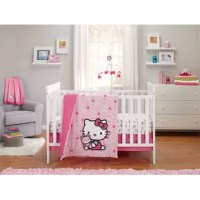 This Crib Bedding Set includes a double-sided comforter with appliqued Hello Kitty against a dimensional pattern of fuchsia, pale pink, aqua, and white polka dots on one side and pink-on-pink polka dots on the other; coordinating dust ruffle; and contrasting crib sheet featuring Hello Kitty and her iconic hair bow and teddy bear patterned against a crisp, white background. Coordinates with a complete line of Hello Kitty Cute as a Button nursery decor.