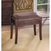 There's a lot of luxury packed into this accent stool. The beautiful and intricate carving on the base is regal and the suede-like neutral upholstery will make this rectangular stool at home anywhere.