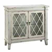 Perfect for display and storage, these two glass door cabinet has a glass storage shelf and a creamy white hand-painted finish.