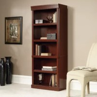 Lend a touch of traditional style to any space in your home with this clean-lined bookcase. Made in the USA from manufactured wood with a paperboard backing, this budget-friendly piece features five tiers (3 adjustable and two fixed) that are perfect for showing off your favorite novels, framed family photos, and anything else you're proud to display. Its tall and narrow silhouette helps you make the most of your square footage, while its classic cherry finish allows it to blend with a variety...