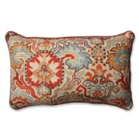 The rich red, orange and blue hues of this striking ikat lumbar pillow make for an impeccable accent in any room. Bask in the warm glow of this boldly designed rectangular pillow with a sophisticated, eye-catching pattern. It reverses to a lovely textured red backing for a fresh look. Additional features of this lumbar pillow include a coordinated cord for a beautiful finish and recycled polyester fiber fill with a sewn seam closure.