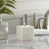 Engraved with a sweet bumblebee motif, this hand-poured candle is perfect for use year-round. Made in Vermont from 100% palm wax, this unscented candle creates a tunnel in the middle as it melts, illuminating the engraving from within as it burns down.