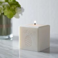 Engraved with a playful pineapple motif, this hand-poured candle is perfect for use year-round. Made in Vermont from 100% palm wax, this unscented candle creates a tunnel in the middle as it melts, illuminating the engraving from within as it burns down.