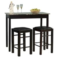 Whether you want a place in your home to sip cocktails while catching up with a friend, or you need a spot to eat quick weekday breakfasts before work, this lovely three-piece counter height dining set is the perfect choice for your home. Brimming with traditional style, this set brings function as well as flair to your space. The simple silhouette and neutral espresso finish let this versatile design blend in with a variety of settings, while the black vinyl seat covers and the faux marble...