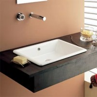 Ensure your bathroom looks stylish with the Scarabeo by Nameeks Gaia Built-In Bathroom Sink. It has a modern style that adds to the look of the bathroom decor. The sink is made from ceramic, which makes it durable and sturdy. It is available in an exquisite glossy white finish that adds to its style-quotient. The drip-free feature of this sink helps prevent the wastage of water. This sink has a rectangular shape that makes it perfect for center placement. The Gaia Built-In Bathroom Sink from...