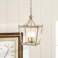 When it comes to overhead lighting, the lights are a fan favorite - and for good reason. They don't take up prime real estate, they offer options for up and downlighting, they work well solo and in clusters, and they come in an endless amount of styles! Take this three-light light, for instance: a lantern style cage adds a traditional look, but its open style gives it a modern touch. Ideal for a small dining nook or entryway, this light provides a glowing presence.