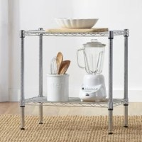 Whether keeping clutter to a minimum in your walk-in closet or organizing the kitchenware in the pantry, this versatile shelving unit is a must-have in your home. Made from metal, its understated utilitarian frame features two tiers of storage space all awash in a polished chrome finish. Each tier is perfect for holding jars of utensils, blenders, or extra gloves and scarves. Plus, it's compatible with casters to ensure easy transport from room to room. This piece measures 24'' H x 24'' W x...