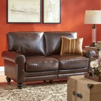 Anchor your seating ensemble in updated traditional style with this sofa. Enveloped in bonded leather, this sofa features a full back, rolled arms, and a deep seat, while its turned bun feet sport a deep espresso finish. Piped edges lend a tailored touch, while foam-filled seat and back cushions provide added comfort and support. Measuring 35
