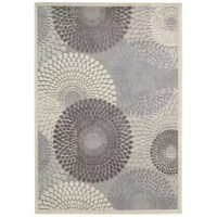 A bold, contemporary pinwheel pattern defines this alluring area rug, showcasing soft hues of gray, ivory, and brown. Made in China, this rug is machine woven from a stain and fade-resistant polyester and acrylic blend in a high-low 0.5'' pile—perfect for laying out in the living room or digging your toes in right out of bed in the morning. Available in a selection of sizes to best suit your space, this rug works best when paired with a rug pad to prevent shifting and sliding.