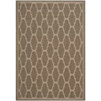 Anchor a wicker coffee table on the patio or lend a subtle touch of pattern to your entryway ensemble with this essential area rug, featuring a bold quatrefoil motif in brown and beige hues.