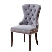 Great for adding to your dining ensemble or pulling out when you have a full house, accent chairs are always a stylish addition. Take this one for example: Crafted from solid wood, this piece comes perched atop tapered legs in an espresso finish. Wrapped in foam-filled polyester velvet, its upholstery features button-tufted detailing and nailhead trim, adding a pop of glam appeal to your arrangement. This product can support up to 200 lbs.