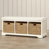 From providing spare seating to storing shoes, blankets, and more, this storage bench is a must-have in any abode. Crafted of solid pine and manufactured wood in a woodgrain finish, this storage bench strikes a rectangular silhouette featuring classic paneling, four bracket legs, and a curved apron base. Three open cubbies accommodate woven wicker baskets (included) to store everything from blankets to toys, while the upholstered seat cushion is filled with comfortable padding for extra support.