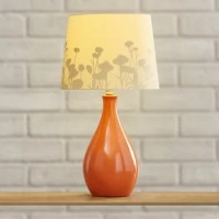 Add a sleek and subtle touch of style to your table tops with this understated lamp, the perfect piece for your well-appointed aesthetic. Featuring a glossy ceramic base with rounded design, this piece offers a neutral look for any ensemble, while its paper drum shade features a subtle floral motif for a garden-chic tinge in the room. Let a pair flank your wooden headboard on two matching nightstands for a glowing and chic master suite, then add in abstract floral rugs and gently stitched...