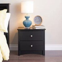 If your bed plays the starring role in your bedroom ensemble, the nightstands are the supporting actors. Take this one, for example, it showcases a clean-lined design and scalloped apron, and is finished off. This two-drawer design measures just 21.75'' H x 23.25'' W x 16'' D, perfect for lower profile beds. Its drawers provide plenty of space for before-bed essentials.
