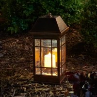 Perfect for illuminating card games on the patio or an evening hot tub soak, this energy-efficient candle lantern features a solar-powered design.
