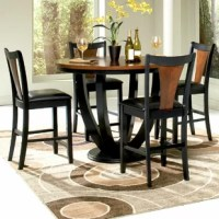 Stylize your dining or kitchen area with this striking contemporary Mayer 5 Piece Counter Height Dining Set. Featured is a lovely two-tone amber and black finish that adds a modern zest to the set. The roundtable features an ornately designed pedestal that holds up an exquisite round wood top. The complementary counter chairs feature sleek legs and decorative backs. Enjoy a nice casual dinner with a few friends using this five piece counter table and counter chair set.