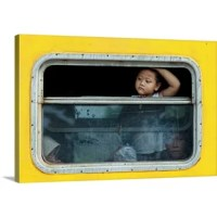 I Want To Go Back Home by Jay Satriani, canvas wall art. A young boy looking out a window of a yellow bus. This proprietary canvas provides a classic and distinctive texture, while archival UV protectant inks make it scratch and fade resistant. The fabric base is flexible to support tight corners. The finished canvas print is mounted on a sturdy yet lightweight board to protect against warping, overstretching, or loose, sagging prints. It is then finished with a closed matboard backing and...