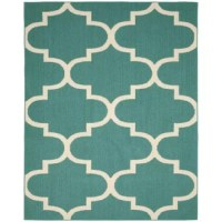 Style and value are what you get with this Large Quatrefoil area rug from Ebern Designs. Designed specifically for someone seeking value and style. The classic Quatrefoil design on this rug will be the perfect accent for any room. Great for that first apartment, college dorm room, living room, home office, or any room needing a modern and classic update. Quatrefoil is machine tufted low pile level loop in Olefin yarn a washable and skid resistant latex backing, on traditional action back...