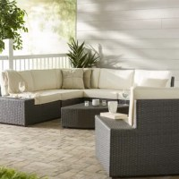 This set includes 7 piece, including a sectional sofa, arm chair, and coffee table. Brimming with contemporary style, its clean-lined frame is crafted of powder coated iron and covered with wicker rattan in a dark solid hue. For added comfort, the seats are topped with neutral-hued cushions, stuffed with foam and featuring a 100% polyester cover so they can resist natural damage from sunlight and rain. Bring this stylish set out back so it can anchor the patio, and suddenly you're ready to soak...