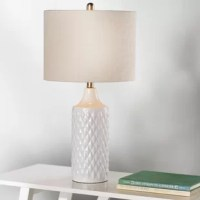 Perfect for adding a touch of style while they light up a room, table lamps are versatile, space-conscious lighting fixtures – and we can't get enough of them! Take this one, for example: perfect for a touch of texture in any ensemble, it's ceramic base features a raised diamond pattern and solid-hued glaze for an eye-catching look. A linen drum shade caps this piece off with understated style, and helps diffuse the 100 W bulb (not included) across the room.