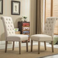 Your dining chairs have two important roles in your home: work with your dinner table to set the tone for your dining ensemble, and give you the perfect perch to settle into a meal. This twist on the classic parson's chair, for example, is a great option for a flea market-find look in any dining ensemble. Crafted from a solid wood frame, this piece features foam filling and polyester upholstery for a padded touch during long chats over dinner. And with button tufting and a rolled back, it...