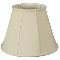 If your home is feeling a little stale, refreshing your lighting fixtures can often give your spaces a new look – and a new lampshade is a great way to do that without buying a whole new lamp! This 18'' empire shade is a great option for a sloping contemporary look atop any luminary. Crafted from hand-tailored shantung silk, this piece can be easily added to a variety of room and lamp styles. A brass-finished spider fitter completes this piece, though we recommend measuring to ensure a...