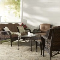 This 6 Piece Sofa Seating Group with Cushions adds a touch of elegance to the patio decor. The coastal design makes it ideal for gazebos and pergolas. Made from steel, the frame of this Sofa Seating Group with Cushions is sturdy and durable. The woven resin wicker material enhances the overall aesthetic appeal. This seating group is available in multiple finishes, letting you choose the one that best suits the patio decor. It includes cushions that provide comfort and support. The set contains...