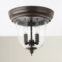 Featuring classic candle-inspired fixtures and seeded glass shade, this striking flush mount casts a warm glow over your master bath or front hallway.