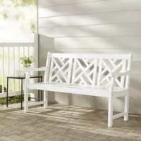 A breezy, contemporary update on a traditional design, this wooden garden bench is an excellent addition to your outdoor ensemble. Crafted from solid acacia wood in a matte white finish, it features a gently-slanted backrest, two curved, fixed arms, and a four-legged trestle base. Its backrest showcases an openwork offset trellis motif, while its gently-contoured seat is slatted so rain falls right through. This bench is a perfect fit for patios and porches alike.