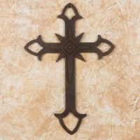 Some people believe the cross is a confession of faith. It symbolizes the belief in God the Father, the Son and the Holy Ghost, explains Byron Toscano of Guatemala. He masters wrought iron techniques to craft this admirable wall cross with rust-colored accents.