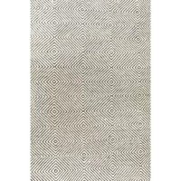 Set a chic, mid-century foundation for your stylish space with this ivory area rug, showcasing a concentric diamond motif. Made in India, this area rug is hand-tufted from a wool and cotton blend in a 0.5