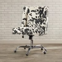 Made to move, this versatile office chair lets you swivel, slide, and sit up higher as you tackle your to-do list. Founded atop a pedestal base with caster wheels, this adjustable seat is crafted with a wooden frame and faux fur upholstery showcasing an eye-catching cow spot pattern. Bronze-finished nailhead trim surrounds the square seat for a decorative touch, while subtly winged sides round out the look with another dash of distinction. Assembly is required.
