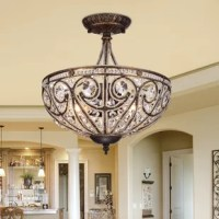 With an antique-bronze finish and an intricate arrangement of crystal beads, this semi-flush mount instantly becomes the center of attention wherever you place it. Illuminate a large area with this chandelier, as it uses three bulbs for multi directional lighting.
