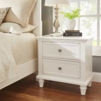 Bring order to your bedroom in classic style with this clean-lined nightstand. Crafted from solid and manufactured wood, this piece features two drawers on soft-close glides that provide a place for bedside essentials. Turned legs bring out its traditional side, while sleek knobs update the look. Up above, there's space to stage a lamp, an alarm clock, framed photos, and more. Assembly is required. Measures 26'' H x 26'' W x 16'' D.